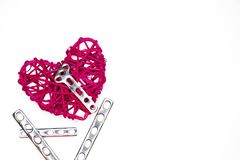 A heart and a steel orthopedic plate royalty free stock photography