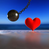 Heart and steel pendulum. Royalty Free Stock Photos