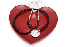 Heart and stethoscope Stock Images