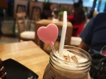 Heart stick and tube in ice coffee stock photo