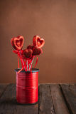Heart on a stick for Valentine's day. On a brown wooden background Royalty Free Stock Image