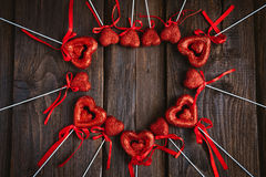 Heart on a stick for Valentine's day. On a brown wooden background Stock Image