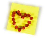 Heart on sticker. Red pushpins Heart on sticker Stock Photo