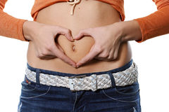 Heart on a stomach Stock Images