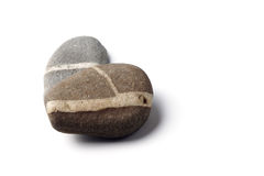 Heart of Stone. Two stacked pebbles, forming a heart, white background stock photography