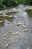 Heart of Stone. A heart of stone in the Patapsco River Stock Photos