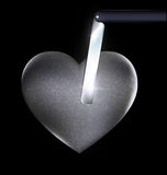 Heart-stone and blade Stock Photos