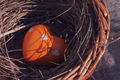 Heart from a stone in a decorative nest Royalty Free Stock Images