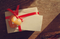 The heart of stone, empty photograph, lie on gift packing with a red bow Royalty Free Stock Photos