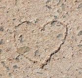 Heart on stone floor Stock Photo