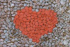 Heart stone red contrast on a gray background symbol of love set of stones painted stones set background base stock photography