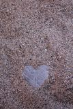 Heart of stone in sand Royalty Free Stock Images