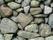 Heart of stone. A heart shaped rock in a dry stone wall Royalty Free Stock Photos