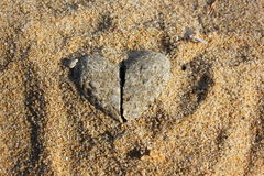 Heart of Stone. Heart shaped stones on a sandy beach Royalty Free Stock Images