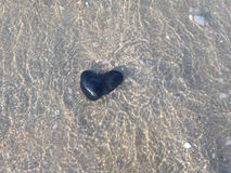 Heart Stone under Water. Stock Image