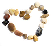 Heart of Stones. Isolated valentine day heart made of pebble stones stock image