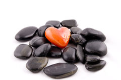 Heart and stones. Red heart on black stones backrdound Stock Photography