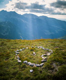Heart of stones in the mountains Stock Image