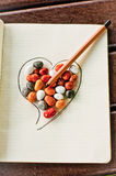 Heart, stones and pencil 1. Heart of stone pierced by pencil, love conquers the hardest of hearts Royalty Free Stock Photography