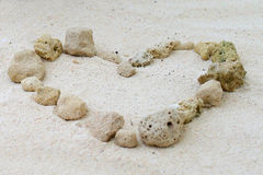 Heart of stones on the sand Royalty Free Stock Images