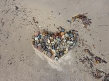 Heart of stones at the sandy beach royalty free stock images