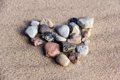 Heart from stones sea sand texture Stock Photography