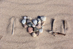 Heart from stones sea sand texture Royalty Free Stock Photography