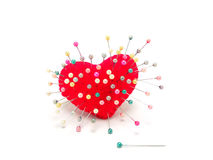 Heart with straight pin. On white background Royalty Free Stock Image