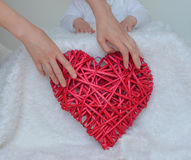 Heart. Straw heart in the hands of mother stock images