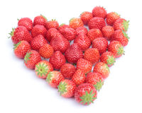 Heart of strawberries. Strawberries shaped to form a heart on white background stock images