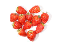 Heart of strawberries on white stock images
