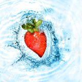 Heart from strawberry dropped into water Stock Photography