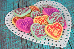 Heart sugar cookies on lace doily Stock Photography