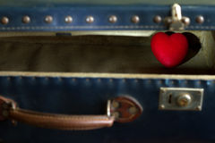 Heart in suitcase abstract of loneliness in love Royalty Free Stock Images