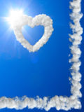 Heart and sun rays. Clouds concept Stock Photography