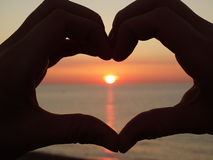 Heart sunset Stock Photos