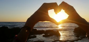 Heart and sunset Royalty Free Stock Image