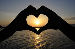 Heart and sunset Stock Photography