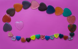 Heart surrounded by hearts on pink-mauve background. Valentine`s Stock Image
