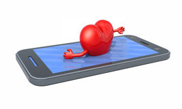 Heart that swims on the screen of the smartphone Royalty Free Stock Image