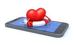 Heart that swims on the screen of the smartphone Stock Photo