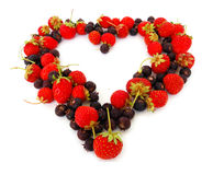 Heart symbol. Duality of feelings - heart symbol made of fresh strawberries and bog bilberries Stock Images