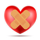 Heart symbol with adhesive bandage Stock Images