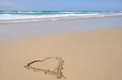 Heart symbol on a beach stock images