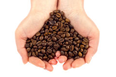 Heart symbol of bean coffee in feminine hand Royalty Free Stock Photo