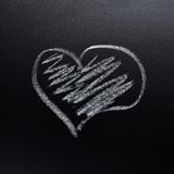 Heart symbol on the blackboard Stock Photo