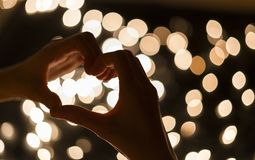 Heart symbol with bokeh lights, Valentine theme.  Stock Photography