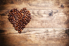 Heart symbol from coffee beans. Stock Photos