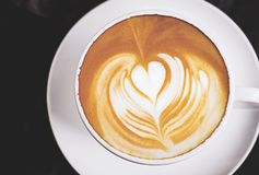 Heart symbol in coffee cup. Heart symbol in latte coffee cup Royalty Free Stock Images