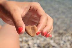 Heart symbol in feminine hand. Conceptual design. close-up royalty free stock photo